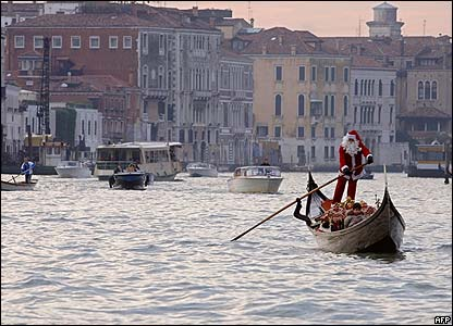 A Venice gondolier dressed as Santa Claus