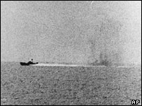 USS Maddox attacked by a North Vietnamese motor torpedo boat in the Gulf of Tonkin, 2 August 1964. Picture from US Navy
