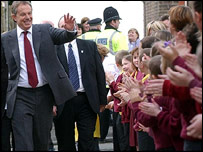 Tony Blair greets children at a school in Bolton