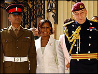 Private Johnson Beharry, his wife Lynthia and army chief General Sir Mike Jackson arrive at Buckingham Palace