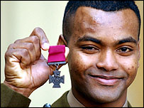 Private Johnson Beharry displays his Victoria Cross
