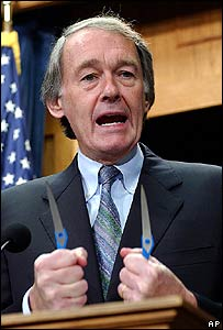 Rep Edward Markey displays separated blades of a pair of scissors
