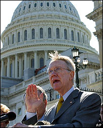 Democratic Minority Leader Senator Harry Reid talks to reporters on Capitol Hill