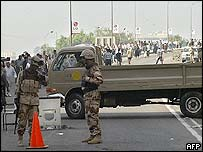 Iraqi soldiers guard a road leading to the National Assembly