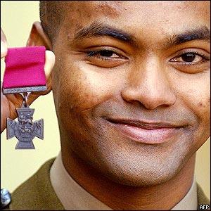 Private Johnson Beharry displays his Victoria Cross at Buckingham Palace