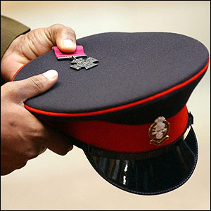 A Victoria Cross in the hands of Private Johnson Beharry at Buckingham Palace