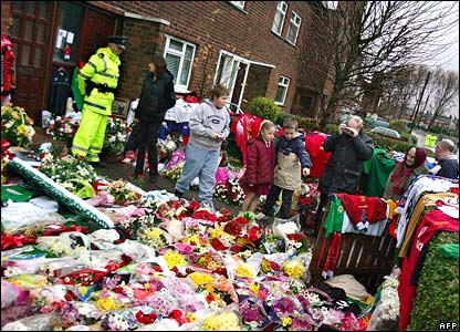 Fans leave tributes to footballer George Best outside his father's home in Belfast, Northern Ireland