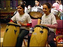 children playing drums in band