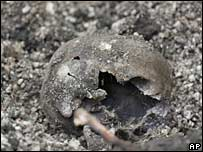 Part of a blackened skull is seen at a site near Montevideo