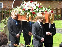 Crispian Mills (right) carries his grandfather's coffins