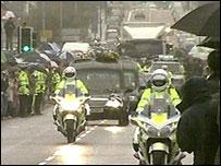 The cortege is escorted through east Belfast