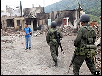 Soldiers patrol the town of Toribio that has been targeted by Marxist rebels