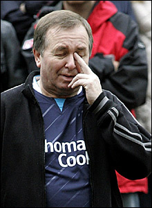 A Manchester City fan wipes away a tear in Exchange Square