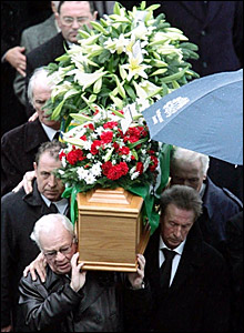 Billy Bingham (front left), Dennis Law (front right) carry the coffin with Derek Dougan (back left) and Gerry Armstrong (centre left)