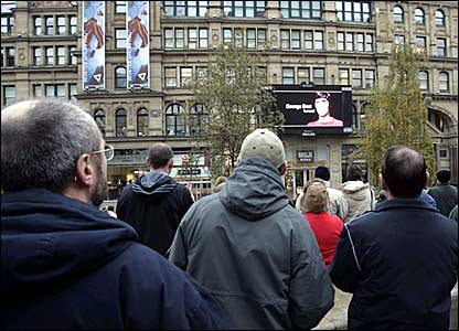 Fans watch George Best's funeral in Manchester's Exchange Square