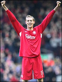 Peter Crouch celebrates scoring his first goal for Liverpool