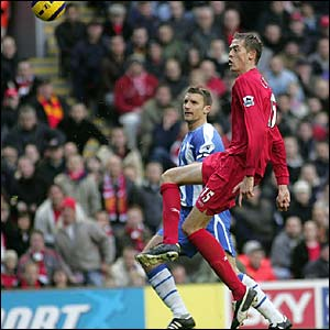 Peter Crouch deftly lobs home his first goal for Liverpool