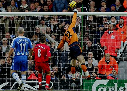 Mike Pollitt turns Peter Crouch's shot into his own net