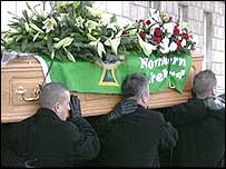 George Best's coffin is carried from the Great Hall at Stormont
