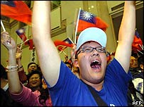 Supporters of Taiwan's Kuomintang (KMT) celebrate, 3 December 2005