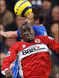 Former Chelsea striker Jimmy Floyd Hasselbaink is challenged by Chelsea skipper John Terry
