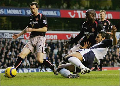 Mido slides home Robbie Keane's low cross at the back post