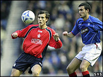 Alan Gow and Ian Murray challenge at Ibrox