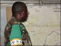 Col Mwandobi looking at a map