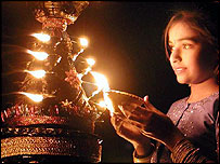 An Indian woman celebrating Diwali