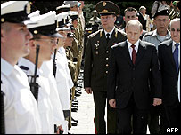 Russian Putin and President Katzav (right) inspect Israeli troops in Jerusalem