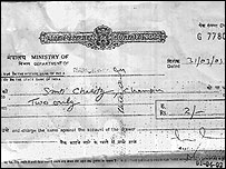Cheque for two rupees paid to Charity Champion