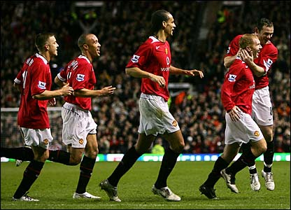 Paul Scholes is mobbed by his team-mates after scoring the winner at Old Trafford