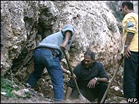 Lebanese inspectors at a mass grave in the eastern town of Anjar