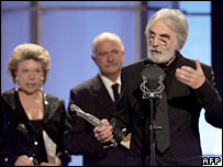 Austrian director Michael Haneke (right) receives the best director prize for Cache