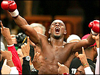 Jermain Taylor celebrates his win