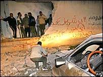 Palestinians inspect missile damage