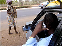 A Togolese man listens to the radio