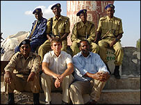 Simon Reeve with Yusuf Abdi Gabobe (front right), his guide in Somaliland, and a few guards