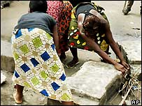 Women in the Togolese capital Lome clean up the streets
