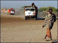 Man walks in front of food aid convoy