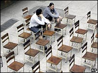 Voters wait among empty chairs in a polling station in Caracas
