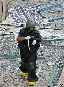 An Israeli policeman at the scene of the bomb