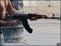 Lebanese militant holds an AK-47