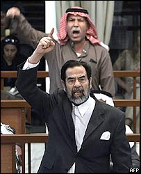 Saddam Hussein and Barzan al-Tikriti in court 5-12-05