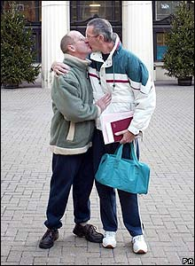 Alan Bond and Derek Peacock kiss outside Brighton Town Hall in the UK