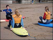 Becky Price teaching surfing to some deaf students in Bude