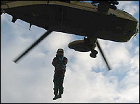 RAF Sea King Rescue helicopter's crew members being winched down