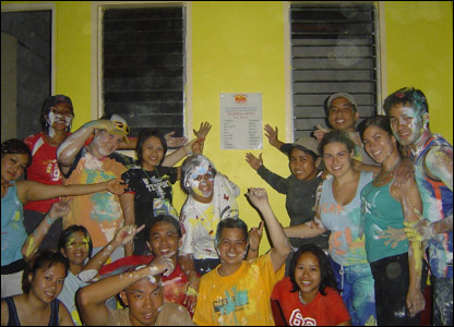 Volunteers from Australia and the Philippines celebrate the completion of a home built through Gawad Kalinga.