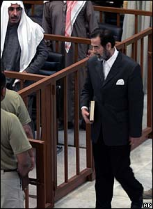Saddam Hussein arrives in court
