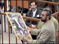 Ahmed Hassan Mohammed in court, with Saddam Hussein visible in the background